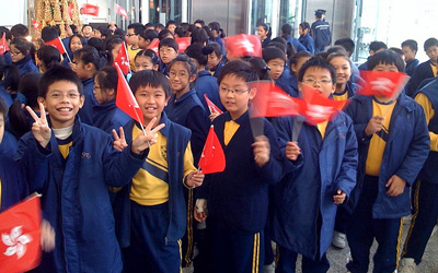 Cantonese kids waving flags, Image Credit: jonrawlinson on flickr