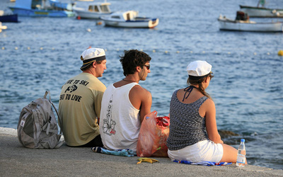 Croatian teenagers looking at boats in a bay, photo credit Alex E. Proimos on Flickr