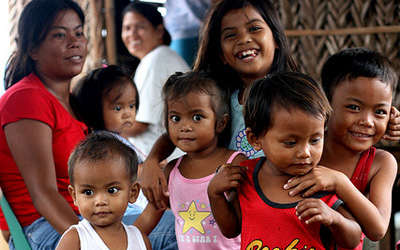 Fillipino kids smiling, photo credit Rain Rannu on Flickr